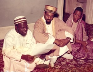 Jafar reading wedding contract for Abdul & Alyah Hassan in the Mosque at State St. [1962]